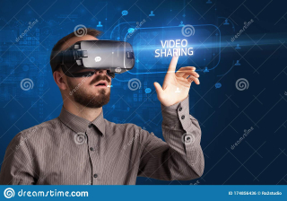 Businessman-looking-virtual-reality-glasses-social-media-concept-video-sharing-inscription-networking-174856436